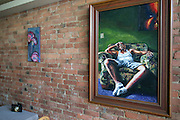 A painting by Johnnie L. Smith on display at Tajze Wine and R&B Lounge  in Rochester on Wednesday, August 19, 2015.