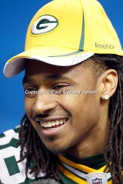 Green Bay Packers cornerback Tramon Williams (38) smiles as he speaks to the press at Super Bowl XLV media day prior to NFL Super Bowl XLV against the Pittsburgh Steelers. Media day was held on Tuesday, February 1, 2011 in Arlington, Texas. ©Paul Anthony Spinelli