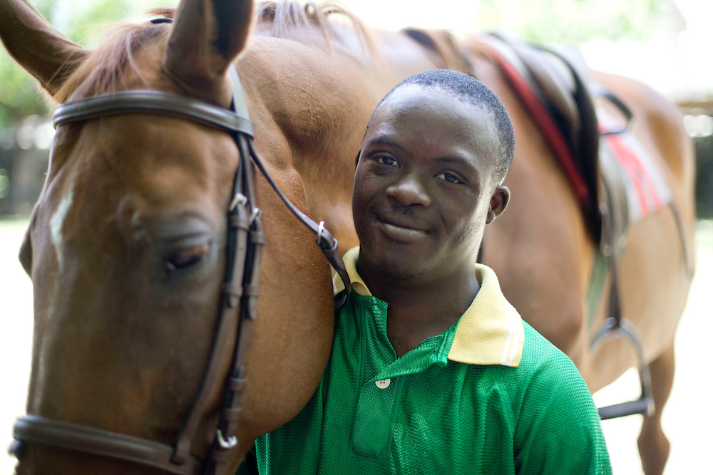 Pierre Michel, 17, (all the chilren's last names are Michel because that is the name of the orphanage director) rides a horse during an equestrian therapy session with Athletic Club Centre Equestre manager Paco Gonzales. For two years Gonzales has been doing equestrian therapy with young people with disabilities from the Wings of Hope orphanage in Fermathe. Gonzales, formally a professional horse jumper, was inspired to start doing equestrian therapy after an accident left him unable to walk for two years. Gonzales says the children have been transformed by the horse riding and some have become more emotionally stable. One of the children, Vivian Michel, has improved her ability to walk. All of the children have learned how to ride.