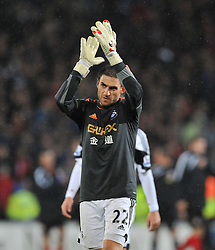 Replacement Goal keeper Swansea City's Angel Rangel Claps the Swansea fans. - Photo mandatory by-line: Alex James/JMP - Tel: Mobile: 07966 386802 03/11/2013 - SPORT - FOOTBALL - The Cardiff City Stadium - Cardiff - Cardiff City v Swansea City - Barclays Premier League