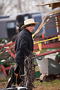 Amish man carries home purchases following the Annual Mud Sale to support the Fire Department in Gordonville, PA.