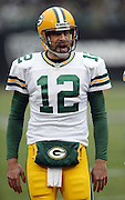 Green Bay Packers quarterback Aaron Rodgers (12) laughs as he comes onto the field for the second half during the 2015 week 15 regular season NFL football game against the Oakland Raiders on Sunday, Dec. 20, 2015 in Oakland, Calif. The Packers won the game 30-20. (©Paul Anthony Spinelli)