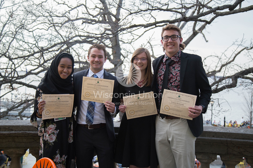 "On Thursday, April 26, 2018, The Wisconsin Union hosted the 111th annual exchange of student leadership.  This annual tradition recognizes the work of the most recent leadership with an awards ceremony and reception.  Then the ""exchange of the gavel"" occurs during the Beefeaters' Dinner in Tripp Commons.  Many past alums, Wisconsin Union Association members and Directorate members celebrate together.  The 1718 WUD Executive officers show off their awards (l-r): Iffat Bhuiyan, Nick Munce, Courtney Medick, Forrest Koslowski."