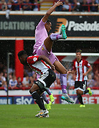 Josh Clarke (Brentford midfielder) fouling Anton Ferdinand (Reading defender) during the Sky Bet Championship match between Brentford and Reading at Griffin Park, London, England on 29 August 2015. Photo by Matthew Redman.