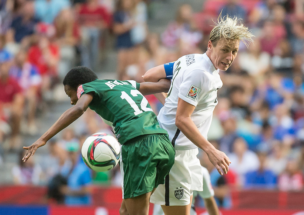 Halimatu Ayinde of team Nigeria and Abby Wambach of team USA in 2015 women's World Cup Soccer in Vancouver during the first round action between USA and Nigeria.