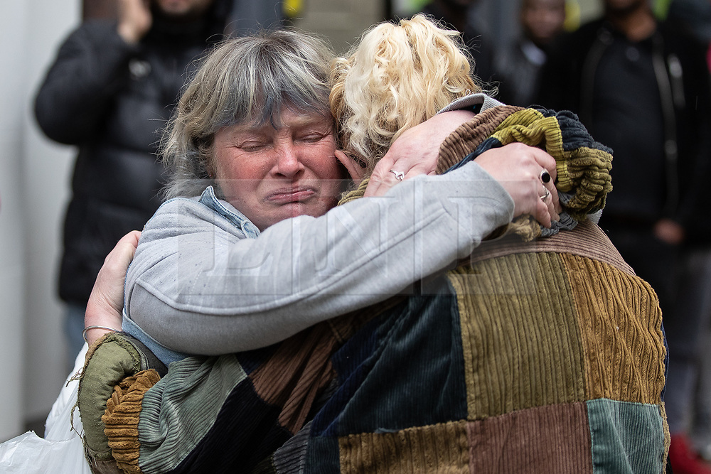 © Licensed to London News Pictures . 03/05/2019. Manchester, UK. A woman comforts another after a loud bang from the location of the suspicious device , believed to be a test carried out by bomb disposal team , causes distress and panic . Police have cordoned off several square blocks around Piccadilly Gardens in Manchester City Centre following concern that a device . A tent has been erected and a man has been arrested in connection with the incident . Oldham Library has also been evacuated on what is believed to be a connected incident . Photo credit: Joel Goodman/LNP