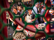 21 JANUARY 2017 - BANGKOK, THAILAND:  People wait for noodle soup during a break at a prayer service in Phra Khanong Market in Bangkok. The market serves a mix of foreign residents, local people, and Burmese migrants.      PHOTO BY JACK KURTZ