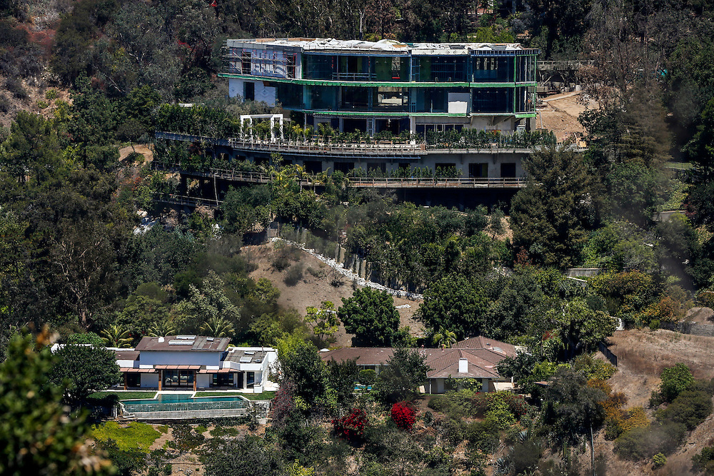 The mansion of Mohamed Hadid under construction at 901 Strada Vecchia stands above the home of Joseph Horacek, lower left, in the Bel Air neighborhood on Thursday, July 16, 2015 in Los Angeles, California. Photo by Patrick T. Fallon for DailyMail.com