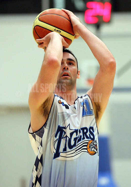 PERTH, AUSTRALIA - JULY 16: Alex Prince of the Tigers shoots a free throw during the week 18 SBL game between the Perry Lakes Hawks and the Willetton TIgers at The State Basketball Center on July 16, 2011 in Perth, Australia.  (Photo by Paul Kane/Allsports Photography)