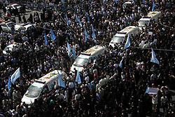 Oct. 4, 2015 - Tehran, Iran - Iranians mourn during a funeral procession for some of the Iranian pilgrims who were killed in a stampede at the annual hajj in the capital Tehran. Ceremonies took place across Iran to honor citizens killed at the hajj, as a second plane returned the bodies of 114 pilgrims from Saudi Arabia.  (Credit Image: © Rouzbeh Fouladi/NurPhoto via ZUMA Press)