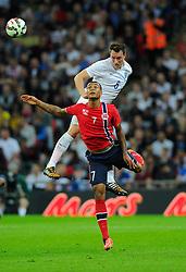 England's Phil Jones (Manchester United) battles for the high ball with Norway's Joshua King  - Photo mandatory by-line: Joe Meredith/JMP - Mobile: 07966 386802 - 3/09/14 - SPORT - FOOTBALL - London - Wembley Stadium - England v Norway - International Friendly