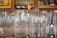Upturned glasses at a pub counter