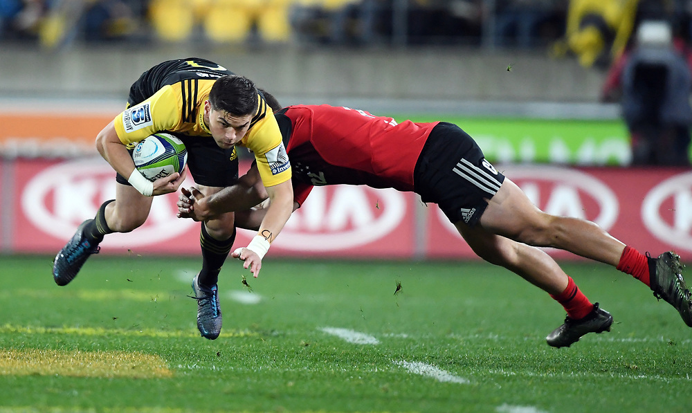 Hurricanes Otere Black, left, tackled by Crusaders George Bridge in Super Rugby match at Westpac Stadium, Wellington, New Zealand, Saturday, July 15, 2017. Credit:SNPA / Ross Setford  **NO ARCHIVING""