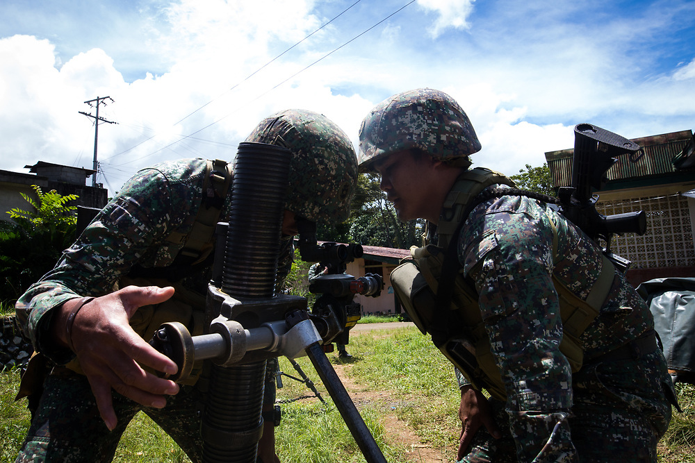 MARAWI, PHILIPPINES - JUNE 9: Philippine marines focus the target as they try to attack remaining Islamist rebels during a heavy fight inside Marawi city, southern Philippines on June 9, 2017. Philippine military jets fired rockets at militant positions on Friday as soldiers fought to wrest control of the southern city from gunmen linked to the Islamic State group. (Photo: Richard Atrero de Guzman/NUR Photo)