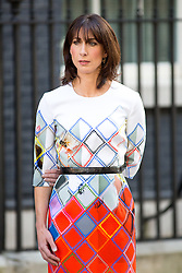 © Licensed to London News Pictures. 24/06/2016. London, UK. Samantha Cameron listens to Prime Minister David Cameron outside 10 Downing Street, as he makes a statement on the result of the EU Referendum and annoucing his resignation. The British public voted to leave the EU in the early hours of this morning. Photo credit : Tom Nicholson/LNP