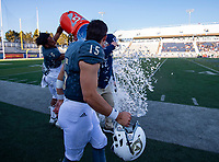 UC Davis Aggies head coach Dan Hawkins has water poured over him after their 56-13 win in the 65th Causeway Classic football game between the Sacramento State Hornets and the UC Davis Aggies at Mackay Stadium at  the University of Reno, Saturday Nov 17, 2018. The game was moved there due to the bad air quality in Sacramento due to the Camp Fire.