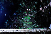Stop motion of a hammer hitting glass at moment of impact glass fragments are dispersed