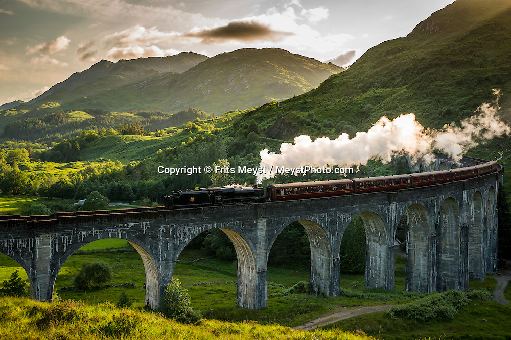Fort William, Scotland, United Kingdom, July 2015. The Glenfinnan viaduct bridges the highlands for the railway that is still serviced by steam train. The Scottish Highlands and wild coastline in combination with the dramatic weather patterns make the region a great outdoor adventure destination for the whole family. photo by Frits Meyst / MeystPhoto.com