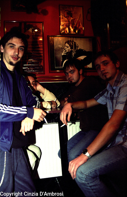 Sarajevo, Rock Teatar Cafe. A group of friends and also a music band. Interestingly their ethnic origins and beliefs wouldn't have allowed them to sit at the same table not long time ago. The friends are all from different backgrounds, from Catholic, Muslim and Orthodox.