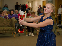 """Josephina Scoog as """"Clara"""" dances with her nutcracker for the Taylor Community as the Lakes Region Dance Company performs The Nutcracker on Monday evening.  (Karen Bobotas/for the Laconia Daily Sun)"""