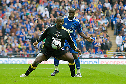 LONDON, ENGLAND - Saturday, May 17, 2008: Cardiff City's Jimmy Floyd Hasselbaink and Portsmouth's Lassana Diarra during the FA Cup Final at Wembley Stadium. (Photo by David Rawcliffe/Propaganda)
