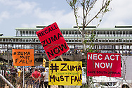 Signs decorate the fences at the Zuma Must Fall march in Newtown, Johannesburg, South Africa on Dec 16, 2015.