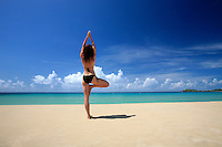 September 2008: Model Sandra Tenuto does morning yoga on the beach on St. Thomas US Virgin Islands beach scenes.  Stock photos available.