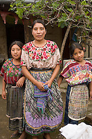 Girls at a family bakery, Comalapa, Guatemala.