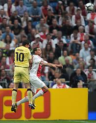 25-04-2010 VOETBAL: AJAX - FEYENOORD: AMSTERDAM<br /> De eerste wedstrijd in de bekerfinale is gewonnen door Ajax met 2-0 / Luigi Bruins en Gregory van der Wiel<br /> ©2009-WWW.FOTOHOOGENDOORN.NL