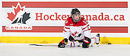 Meaghan Mikkelson stretchs as Canada's national women's hockey team hosts Team USA in a pre-Olympic exhibition game at Winsport, Markin MacPhail Centre in Calgary, Alberta on December 12, 2013.