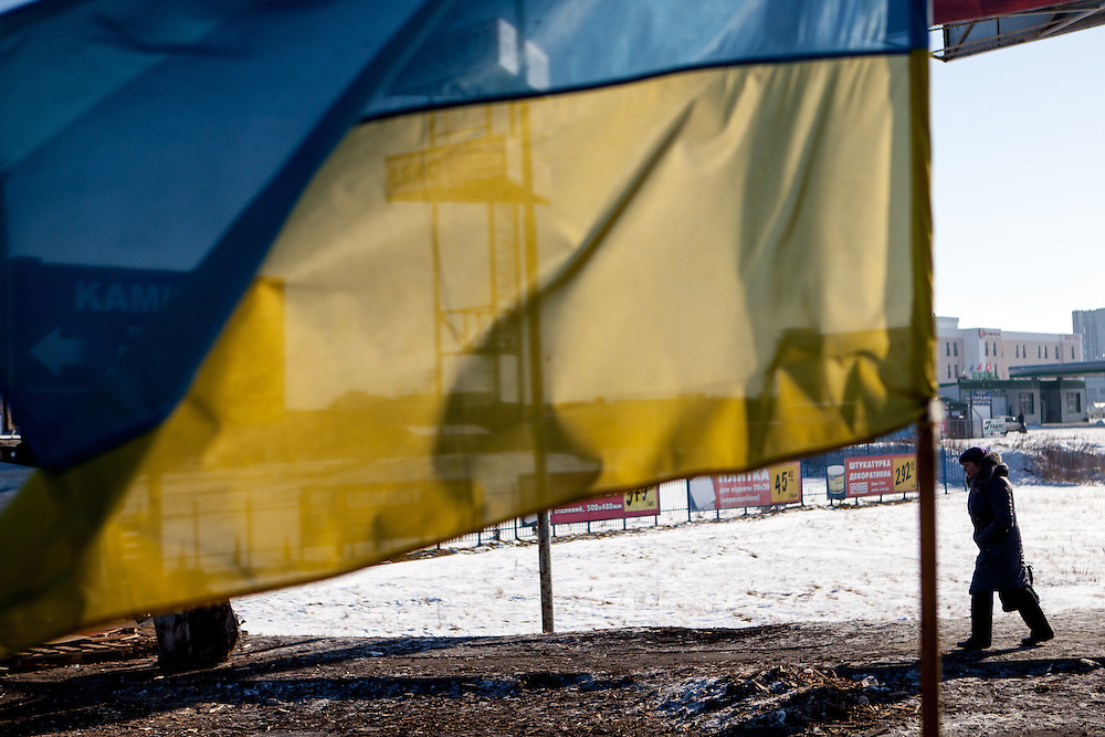 """The ukrainian flag at the barrikades blockading a building supplies store named """"Epicenter"""" in the city of Lviv, Ukraine."""