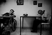 Holocaust survivors sit in a hall at the Shaar Menashe Mental Health Center for Holocaust survivors in Pardes Hanna, Israel on July 5, 2010.