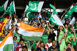 © Licensed to London News Pictures. 30/09/2012. Indian and Pakistani fans waving flags during the T20 Cricket World super 8's match between India Vs Pakistan at the R Premadasa International Cricket Stadium, Colombo. Photo credit : Asanka Brendon Ratnayake/LNP