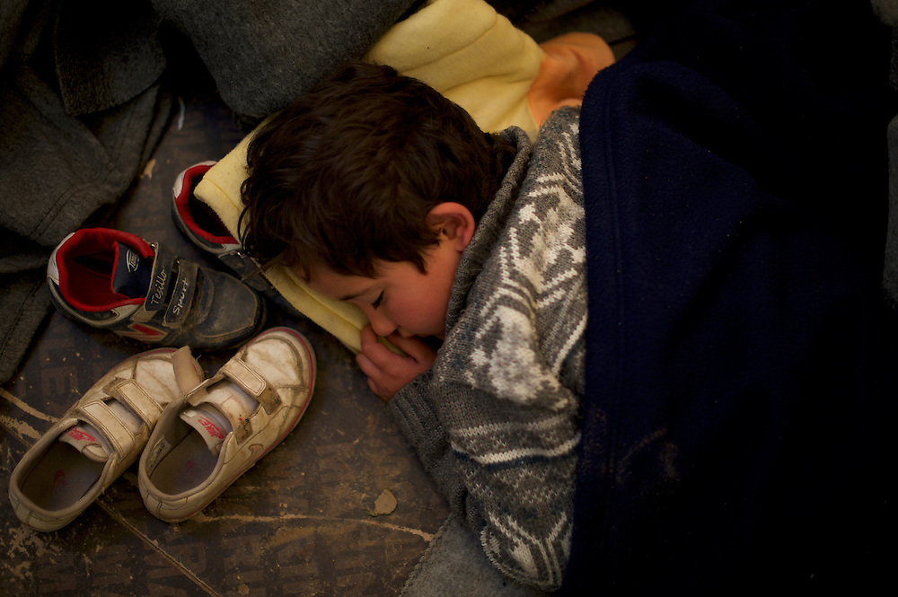 A Syrian child sleeps on the floor of a emergency hospital tent run by volunteer organisations at the border between Greece and Macedonia in Idomeni, Greece. Around 13,000 migrants and refugees, mostly from the Middle East and African nations, are believe to be stranded here awaiting a chance to proceed their journey towards Germany and other northern European countries.