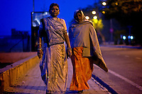 Two women walk in the early morning in Jaipur City india Nov. 16, 2006 Jaipur India.    (photo by Darren Hauck)..