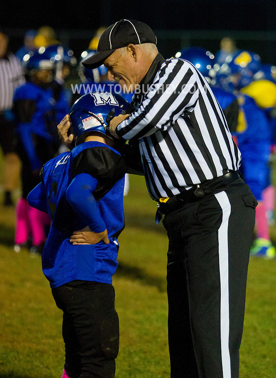 Middletown, New York  - An official helps a Middletown player with his helmet in an Orange County Youth Football League game at Watts Park on Oct. 11, 2014.