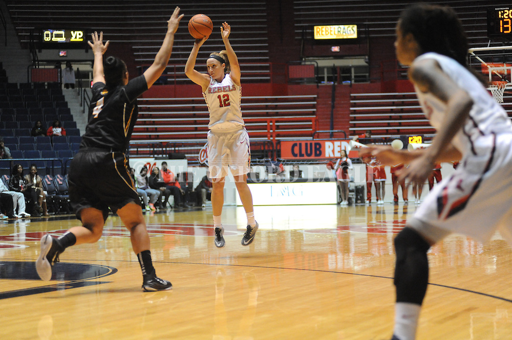 """Ole Miss Lady Rebels guard Gracie Frizzell (12) makes a three pointer over Southern Mississippi Lady Golden Eagles forward Tamara Jones (4) at the C.M. """"Tad"""" Smith Coliseum in Oxford, Miss. on Thursday, December 18, 2014. (AP Photo/Oxford Eagle, Bruce Newman)"""