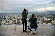 Tourists Overlooking Downtown Los Angels from the Observation Deck of OUE Skyspace