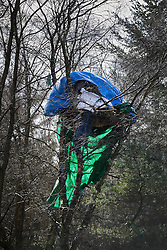 © Licensed to London News Pictures. 02/03/2017. Coldharbour, UK. A tree top camp near the main 'Protection Camp' fortress on Leith Hill. Activists have constructed and occupied a fort and some trees on the site of a proposed oil well. Planning permission for 18 weeks of exploratory drilling was granted to Europa Oil and Gas in August 2015 after a four-year planning battle. The camp was set up by protestors in October 2016 in order to draw  attention to plans to drill in this Area of Outstanding Natural Beauty (AONB) in the Surrey Hills. The camp has received support from the local community.  Photo credit: Peter Macdiarmid/LNP