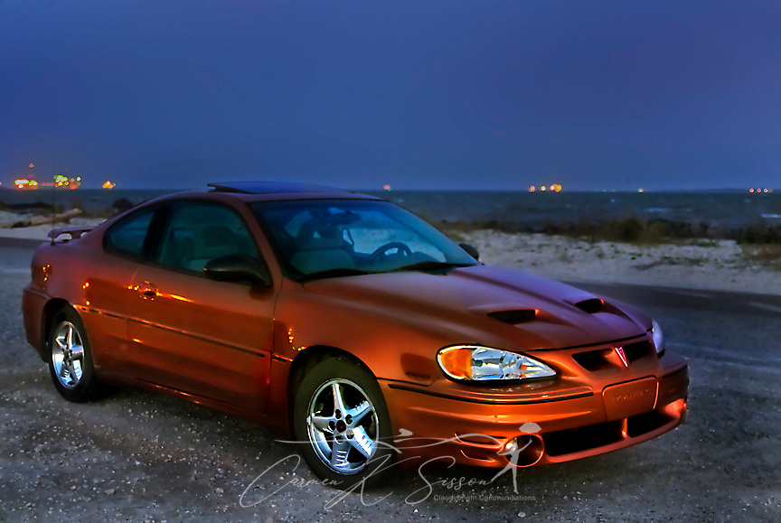 A 2004 Pontiac Grand-Am is pictured at sunset on the east end of Dauphin Island in Alabama on Dec. 3, 2011. (Photo by Carmen K. Sisson/Cloudybright)