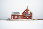 The historic Prince's building on Orr's Island stood out starking in red against a raging white snow.