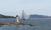 Open Season (Thomas Bscher) with Galataiea on the left and Magic Carpet 3 (Sir Lindsay Owen Jones) on the right with the Porto Faro lighthouse during the Rolex Maxi Cup 2017, Costa Smeralda, Porto Cervo Yacht Club Costa Smeralda (YCCS).