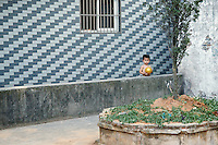 Boy with a golden ball.  Wenzhou, China.