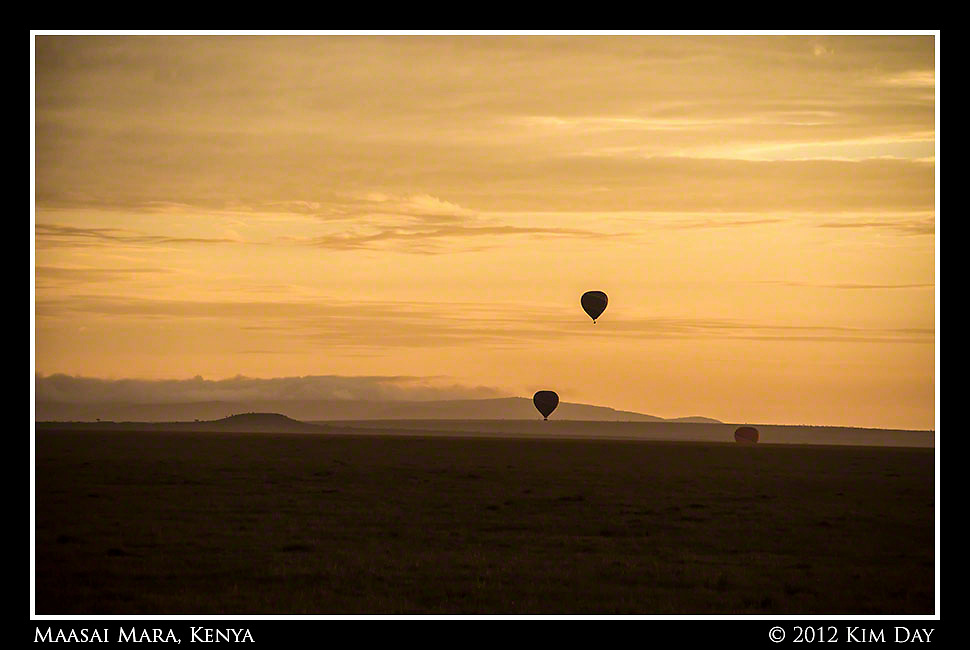 Silhouetted Balloons Against Orange Sunrise.Maasai Mara, Kenya.September 2012