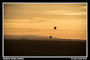 Silhouetted Balloons Against Orange Sunrise.Maasai Mara, Kenya.September 2012