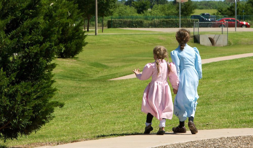 Danielle, right and Autumn, children of FLDS mother Sarah Barlow Draper play outside their home in Abilene, Texas on Monday June 2, 2008. They had reunited with their mother following the court order which released the children back into the custody of their mothers. August MIller/ Deseret News .