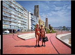Benidorm,Valencia,Spain<br /> Two elderly ladies in bikini are walking along the seafront.<br /> &copy;Carmen Secanella