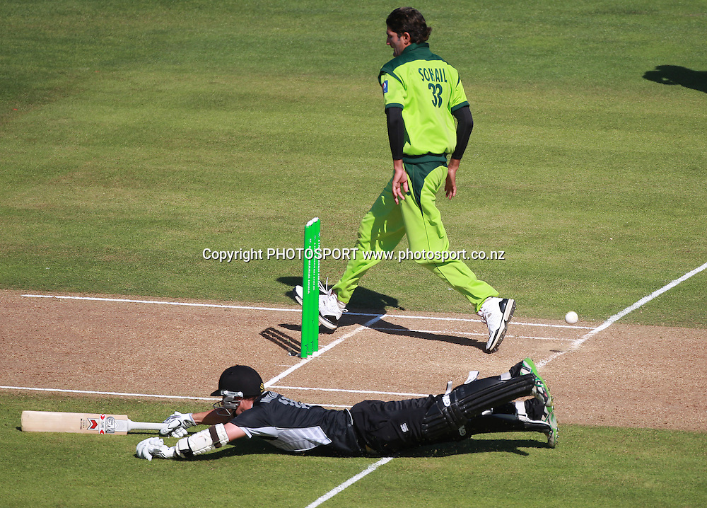 Nathan McCullum just makes his ground as Pakistan bowler Sohail Tanvir attempts to kick the ball during the 4th ODI, Black Caps v Pakistan, One Day International Cricket. McLean Park, Napier, New Zealand. Tuesday 1 February 2011. Photo: Andrew Cornaga/photosport.co.nz