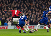 Football - 2018 / 2019 Emirates FA Cup - Fifth Round: Chelsea vs. Manchester United <br /> <br /> Paul Pogba (Manchester United) tries to break away from Cesar Azpilicueta (Chelsea FC)  at Stamford Bridge<br /> <br /> COLORSPORT/DANIEL BEARHAM