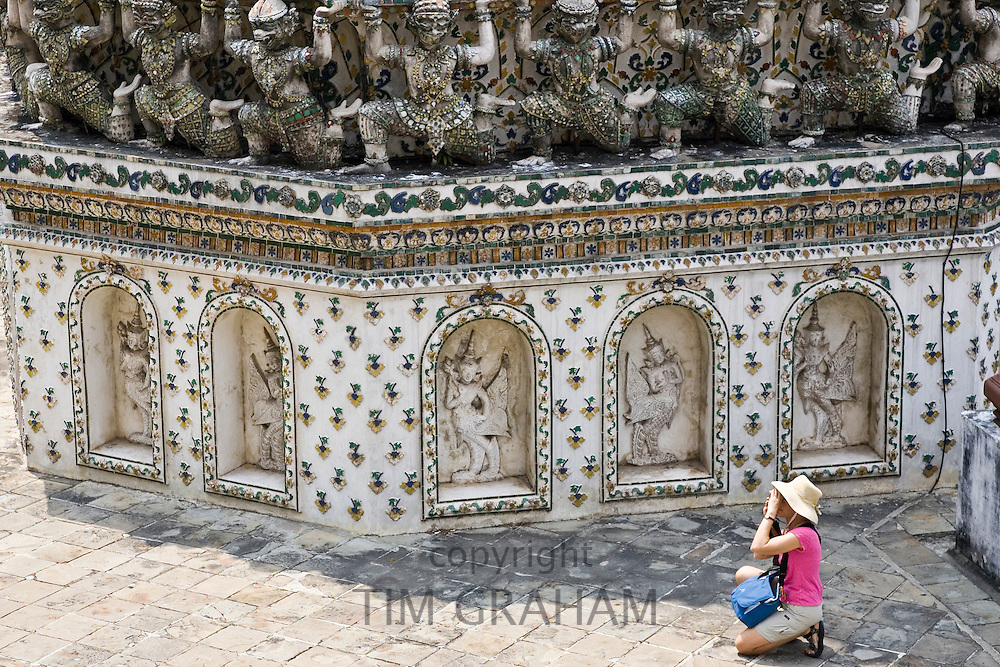 Tourist taking photograph at Wat Arun,Temple of the Dawn, Bangkok, Thailand